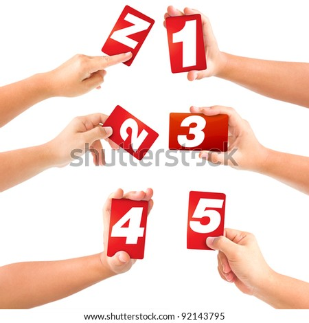 alphabet symbol card in a hand on white background.