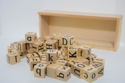 alphabets on wooden cubes, isolate background.