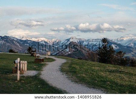 Alpine getaway paradise with mountain path and view to snowy mountain summits in Austria. Restoration of health with clean air, jogging and hiking in peaceful and calming environment in Europe. #1408951826