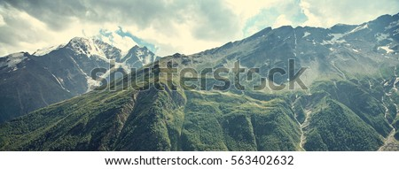 alpine landscape with peaks...