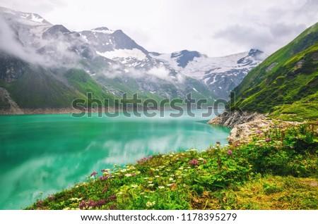 Alpine mountain lake at cloudy day.