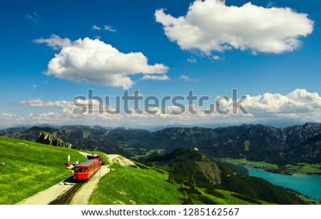 Alpine rack railway track to Schafberg, where steam train takes tourists on a mountain peak in the Austrian Alps near Salzburg  at Schafberg Peak.