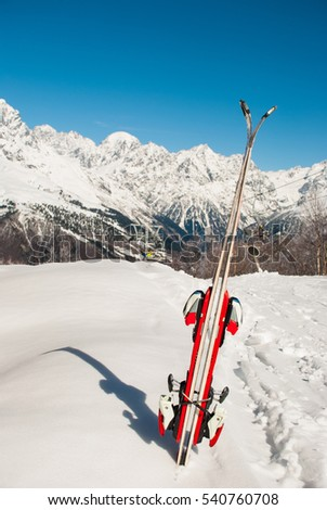 alpine skis, slopes and chairlift in winter mountains #540760708