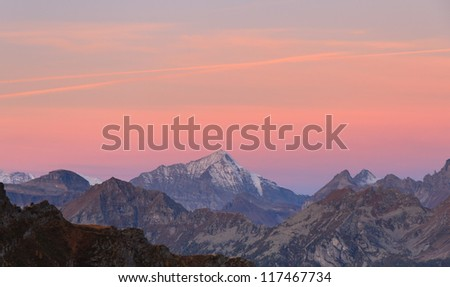 Alpine sunrise with orange/pink morning glow.