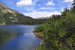 Alpine terrain and lake on Colorado 14er Snowmass Mountain, Elk Range, Colorado. Rocky Mountains, USA