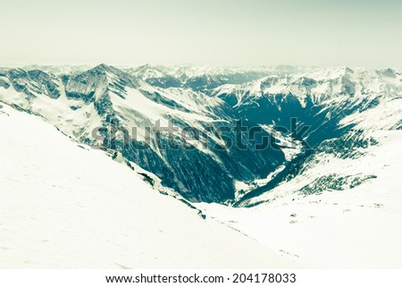 alpine valley surrounded with...