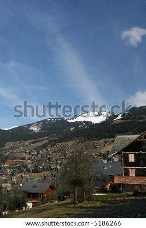 Alpine village and valley with mountains and chalets, blue sky		Chatel,French Alps,	France