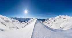 Alpine winter landscape of the Nebelhorn mountain near Oberstdorf, Germany, on a sunny day.