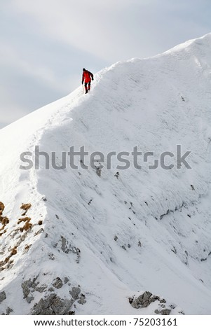 Alpinist climbing a mountain - stock photo