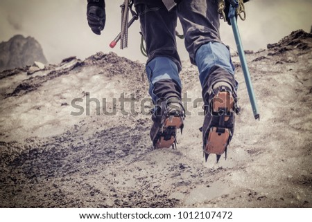 alpinist climbing on glacier ...