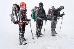 Alpinists facing a mountain blizzard