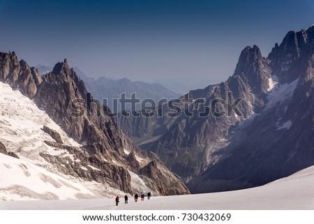 Alpinists walk to climb at Mont Blanc massif, France
