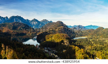 Alps and lakes in a summer day in Germany. Taken from the hill next to  Neuschwanstein castle #438925954