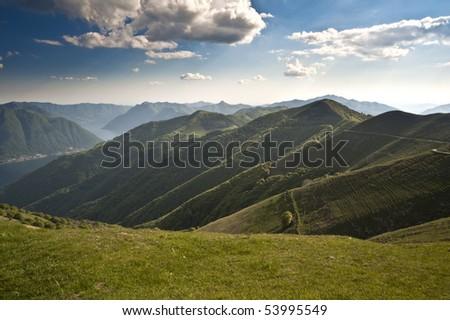 alps at lake como - stock photo