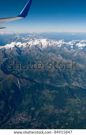 alps between switzerland and italy seen from the plane - stock photo