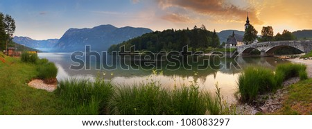 Alps in Slovenia - lake Bohinj in national park Triglav, Mountain panorama at sunrise