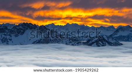 Alps panorama sunset colored sky winter snow foggy clouds austria germany nature landscapes bavari. mountain sunset sky zoom. Photo stock ©