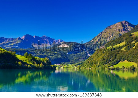 Alps summer mountain landscape with lake.