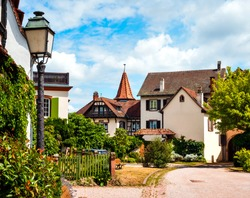 Alsace's sun-drenched gingerbread houses. Tiled roofs, flowers all around, the summer sun is shining. Beauty. France