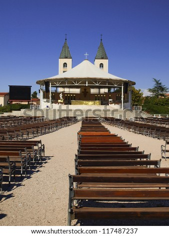 Altar and the Church of St. James, in a holy place of pilgrimage - Medjugorje, Bosnia and Herzegovina. Balkans, summer day.