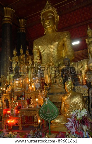 Altar, Golden Buddha in an environment of set of figures