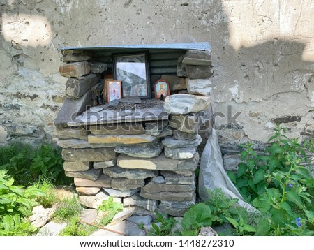 Altar in old church of the Assumption in the ancient village of Lisri in the Mamison gorge in the summer. Russia, North Ossetia - Alania #1448272310