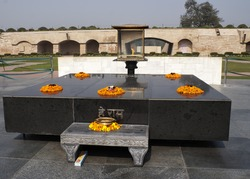 Altar like platform with eternal flame on the spot where Gandhi was cremated.