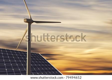 alternative Energies with nice sundown in back - stock photo