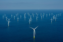 Alternative energy - Aerial view of offshore windmill park at sea.