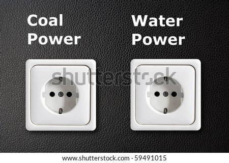 alternative energy concept with power outlet on black background