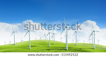 Alternative energy.  Group of energy-producing windmills agains blue sky