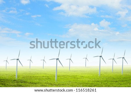 Alternative energy. Group of energy-producing windmills. Concept