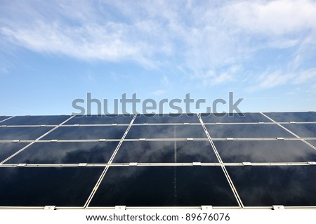 Alternative energy photovoltaic solar panels against blue sky