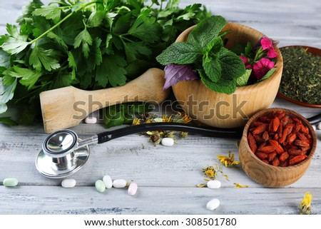 Alternative medicine herbs and stethoscope on wooden table background Foto stock ©