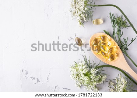 Alternative medicine, naturopathy and dietary supplement. Herbal remedy and plants. Top view with copy space Stock photo ©