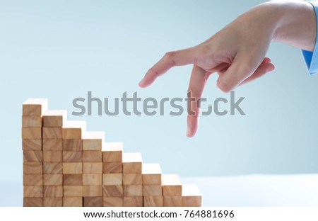 Alternative risk concept, plan and strategy in business, Risk To Make Business Growth Concept With Wooden Blocks, hand of man has piling up and stacking a wooden block. #764881696