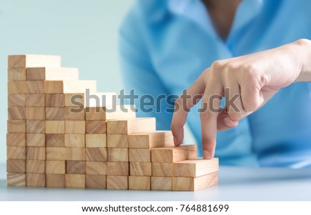 Alternative risk concept, plan and strategy in business, Risk To Make Business Growth Concept With Wooden Blocks, hand of man has piling up and stacking a wooden block. #764881699