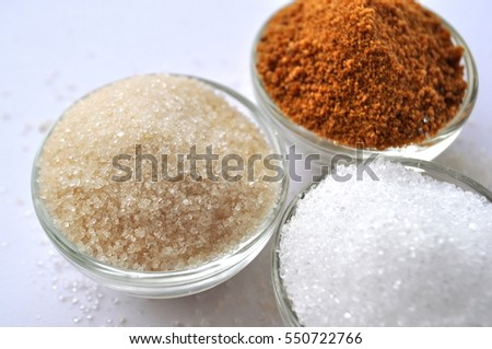 Alternative sweeteners - organic coconut sugar, xylitol, cane sugar, in glass bowls