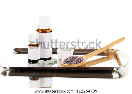 Alternative therapies on the silver tray isolated on white background close-up