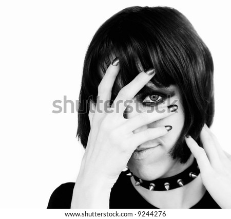 Alternative young woman with covering her face with her hand.