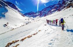Altitude hiker sport team climb on snow mountain