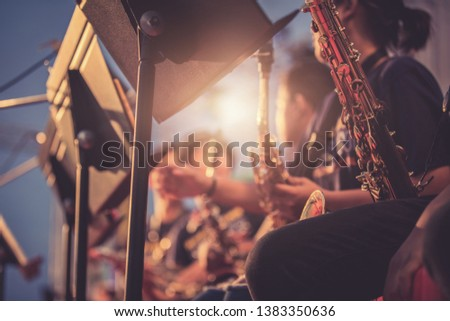 Alto sax musical instrument closeup,jazz musician playing outdoor concert