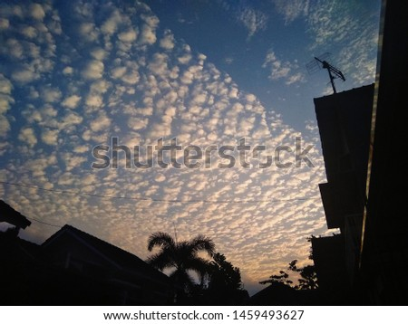 Altocumulus cloud, in the afternoon, during the twilight sky