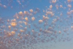 Altocumulus clouds, usually appear between lower stratus clouds and higher cirrus clouds, photographed over the beach, Spain