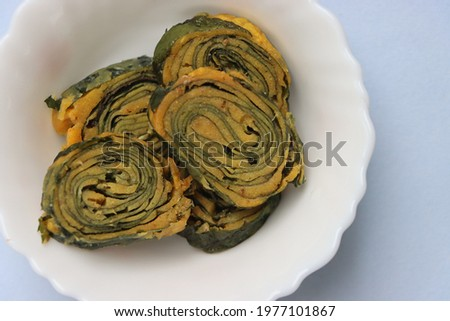 Alu Vadi, Patra, colocasia or taro leaves rolls, traditional maharashtrian and Gujrati snack, festival food Stok fotoğraf ©