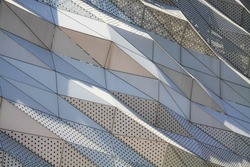 aluminium composite panels or cladding with perforated sheets on modern building facade, Abstract architecture background concept.