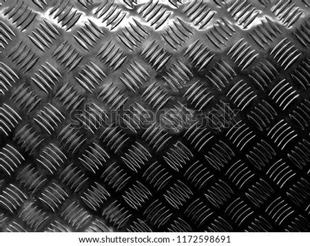Aluminium dark list with rhombus shapes. Industrial shiny metal silver list with rhombus shapes. #1172598691