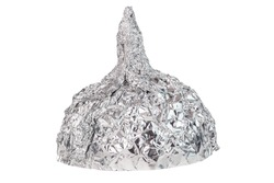 Aluminium foil hat isolated on white background, symbol for conspiracy theory and mind control protection.