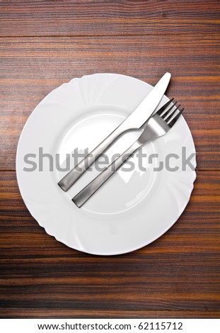 Aluminium fork and knife on a white plate