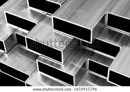 Aluminium profile for windows and doors manufacturing. Structural metal aluminium shapes. Aluminium profiles texture. Aluminium constructions factory. Black and white Stockfoto ©